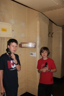 The boys underground in Churchill War Rooms....the sign tells you what the weather is like outside.