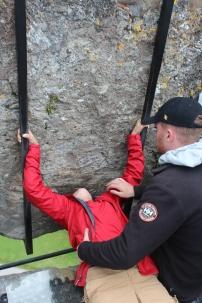 Isaac kissing the Blarney Stone.