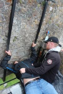Nathan kissing the Blarney Stone.