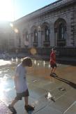 Having fun in the fountains.