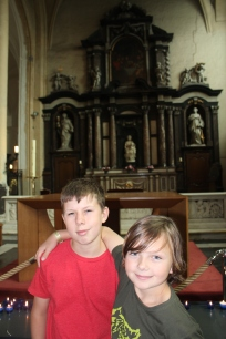 The boys with the Madonna and Child sculpture (by Michelangelo) behind them.