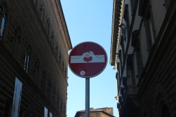 Florence, the city of art...lots of street signs had creative tweaks to them.