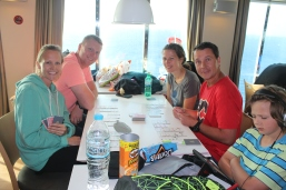 Playing cards on the ferry ride to Santorini.