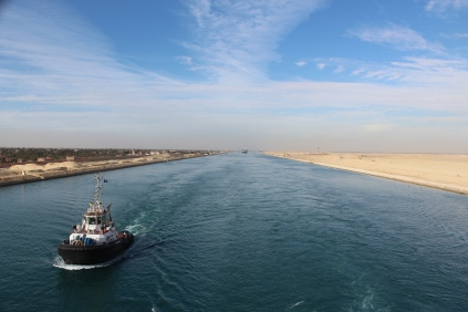 Cruising down the Suez Canal in Egypt. We were in a caravan of about 15 boats. And had a pilot brought on to steer through the canal.