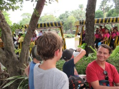 "We really felt our ""whiteness"" in Thailand. Lots of people asked for a picture with Jo. Here, the cousins are waving at a bus going by in the zoo."