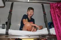 Isaac gets the top bunk on the train