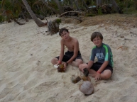 The boys trying to crack some coconuts